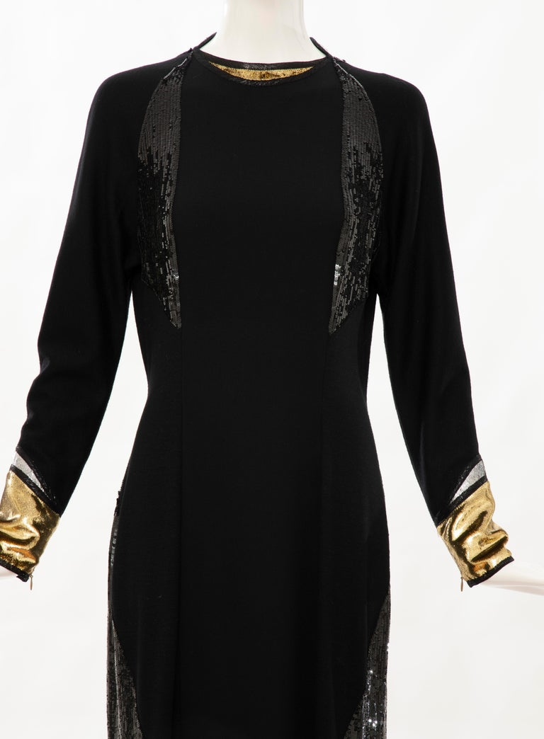 Geoffrey Beene Runway Fall 1992, black silk crepe & wool jersey evening dress with black embroidered sequins, gold and black silk metallic zip cuffs and neckline, front slit, back zip and hook-and-eye closure and lined in silk chiffon.  US. 8  Bust: