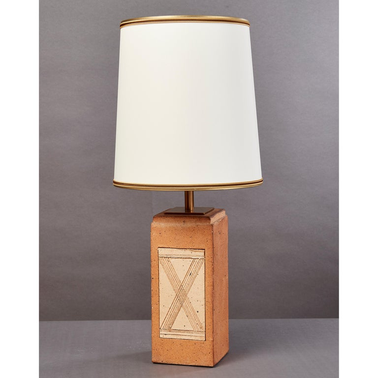 France, 1970s Geometric fired ceramic lamp with incised abstract geometric motifs Rewired for use in the US with one standard base bulb One of a collection of French, 1970s fired ceramic lamps, see last two images for two oval shaped