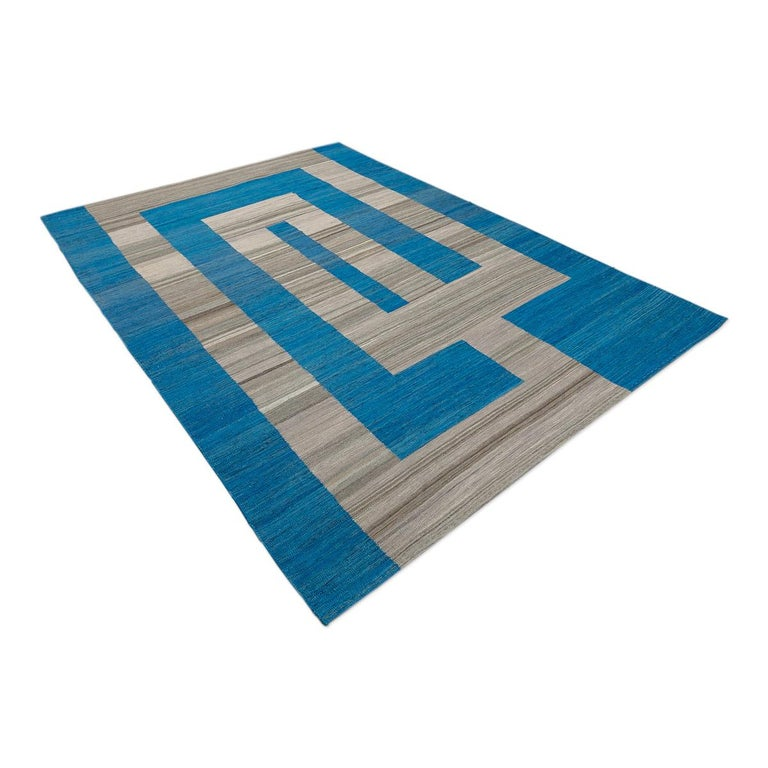 Modern Kilim made by hand in 100% wool. - Modern design in blue and gray tones. - The combination between design and color is elegant and current. - Our customers love to put this type of rug in casual decorations will give a touch of distinction