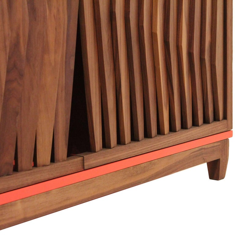 The FIN cabinet is crafted on walnut solid wood, by artisans in México. Is the perfect iconic piece for your dining room or bar area. Is part of FIN collection that came to light after a process of formal explorations; Lines and rhythms that