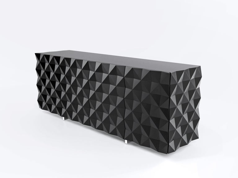 Buffet drawers from the Rocky collection designed by Joel Escalona, configured with four large sections of storage with their respective doors, detailed in its sides and front with pyramid pattern.  Made in Mexico.  Details: Made of particle