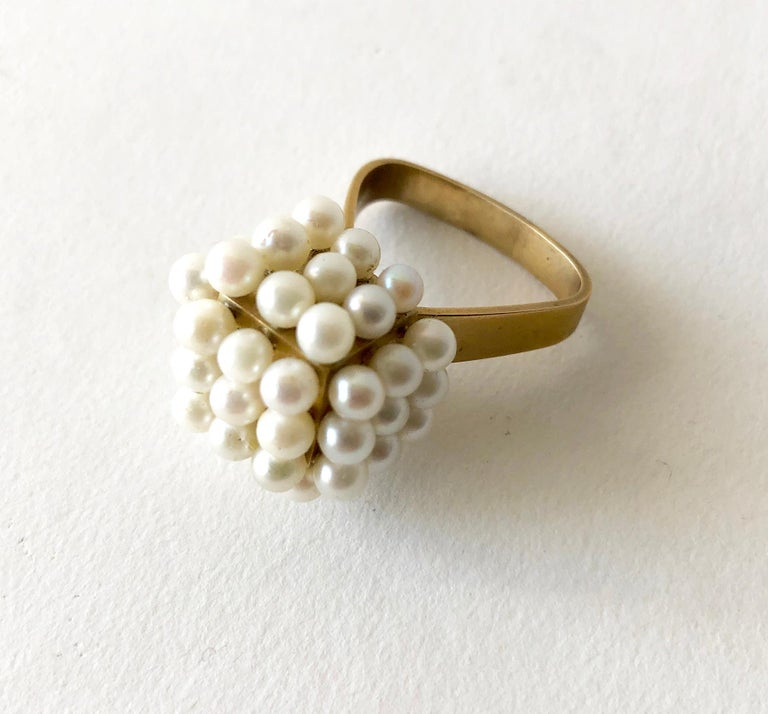A custom made genuine pearl ring set in 18K gold vermeil over silver, circa 1960's.  Cube measures  3/4