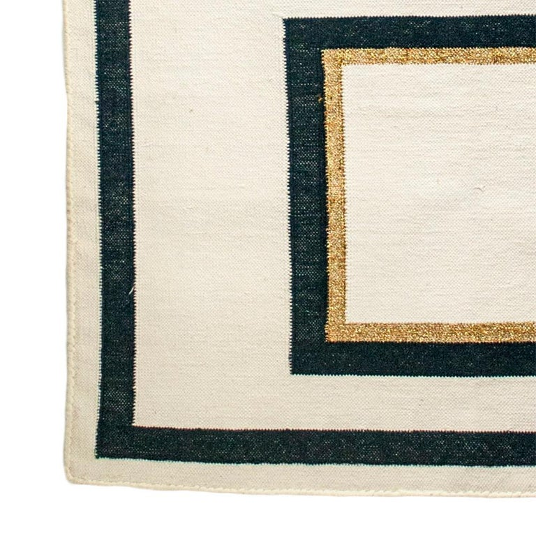 This rug has been handwoven in the finest cotton yarns by artisans in Rajasthan, India, using a traditional weaving technique which is native to this region.  The purchase of this handcrafted rug helps to support the artisans and preserve their