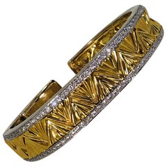 Geometric Design Hinged Gold Bangle with Diamond Edges