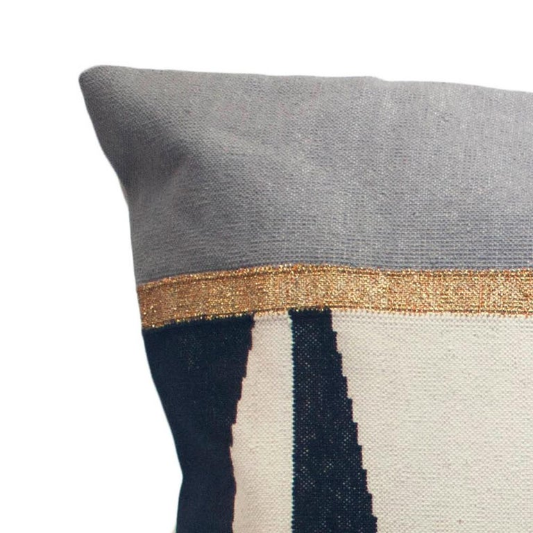 This pillow has been handwoven by artisans in Rajasthan, India, using a traditional weaving technique which is native to this region.  The purchase of this handcrafted pillow helps to support the artisans and preserve their craft.  We have used