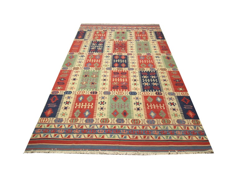 These handmade carpet natural rugs are handmade carpet using high-quality wool and cotton. These colourful rugs are woven in Afghanistan. This oriental rug has purple, red, orange, yellow, pink, white and green colours. Afghan rugs would complement