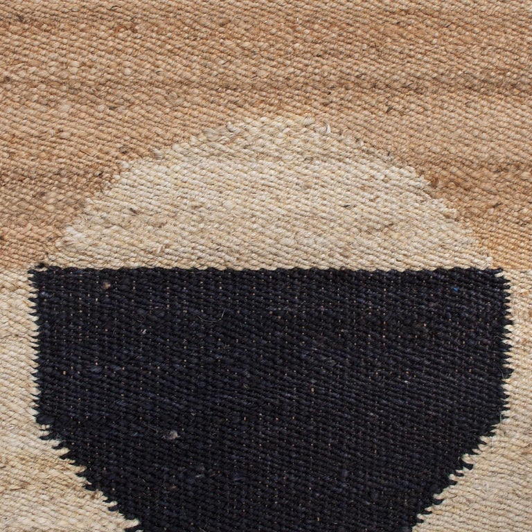 This rug has been handwoven in the finest jute yarns by artisans in Rajasthan, India, using a traditional weaving technique which is native to this region.