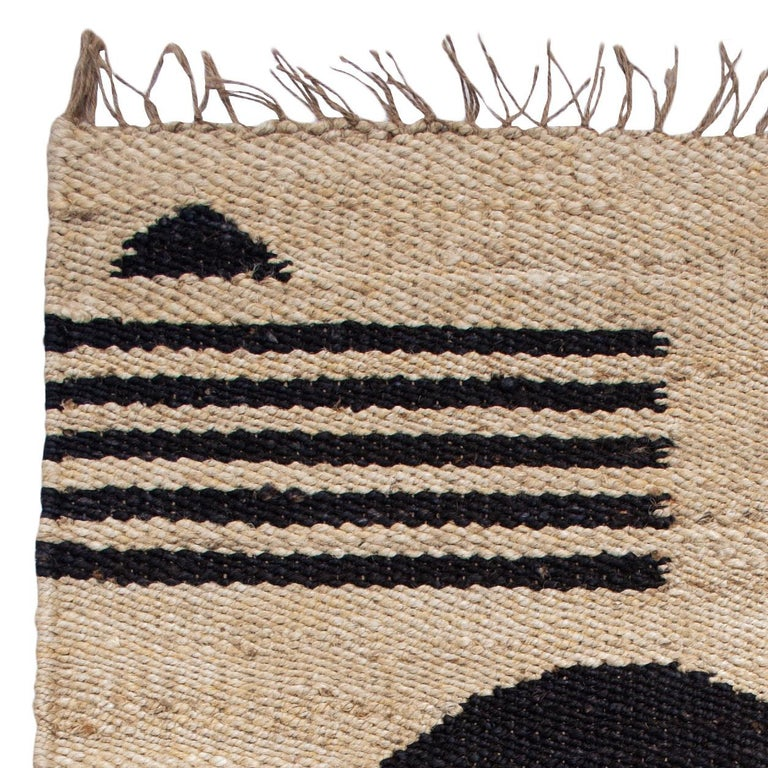 This rug has been handwoven in the finest jute yarns by artisans in Rajasthan, India, using a traditional weaving technique which is native to this region.  The purchase of this handcrafted rug helps to support the artisans and preserve their