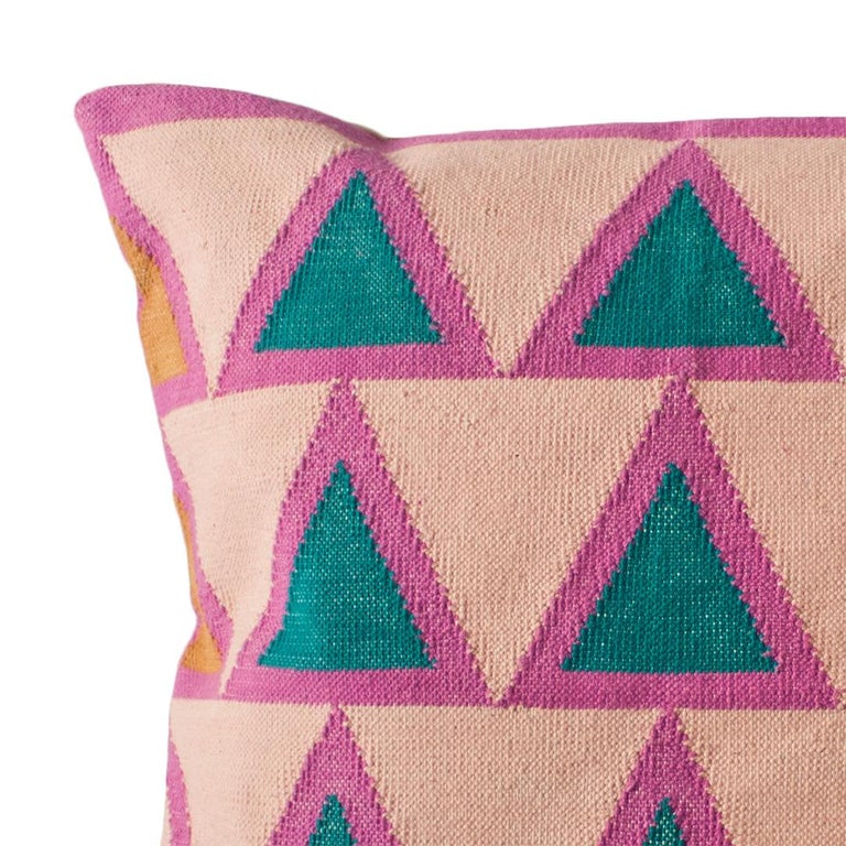 This pillow has been handwoven by artisans in Rajasthan, India, using a traditional weaving technique which is native to this region.