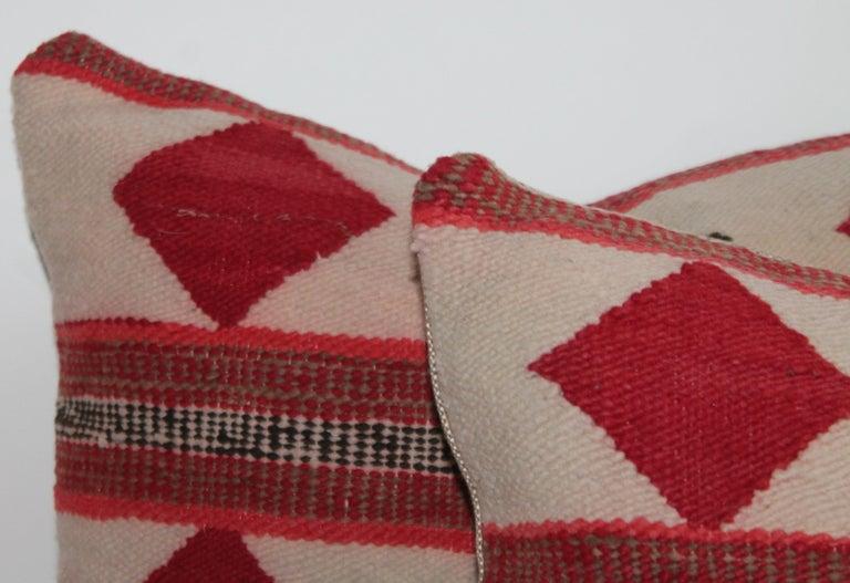 Geometric pair of Navajo Indian pillows with diamond and stripe design.