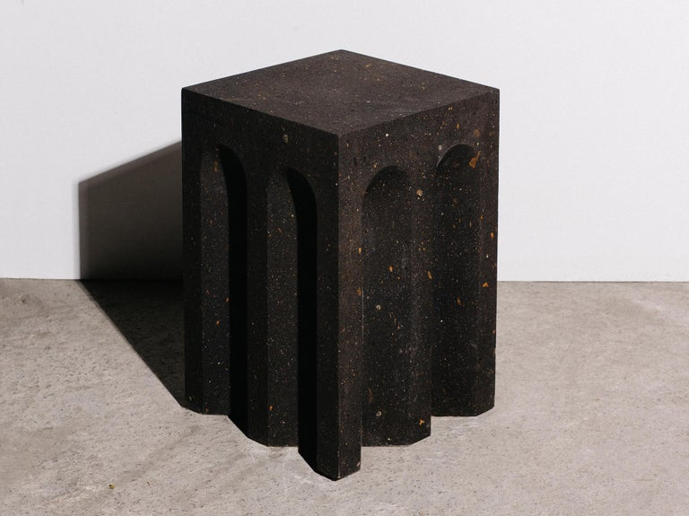 The Source side table no. 5 by the Brooklyn-based, woman-owned studio A Space is handcrafted from black tuff — a light, porous rock formed by the consolidation of volcanic ash — in a limited edition of 10.  This collection is inspired by
