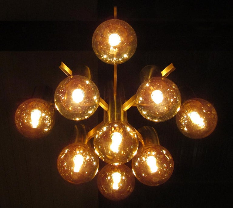 A geometric 1970s chandelier with opalescent art glass shades by Swedish designer Hans-Agne Jakobsson.