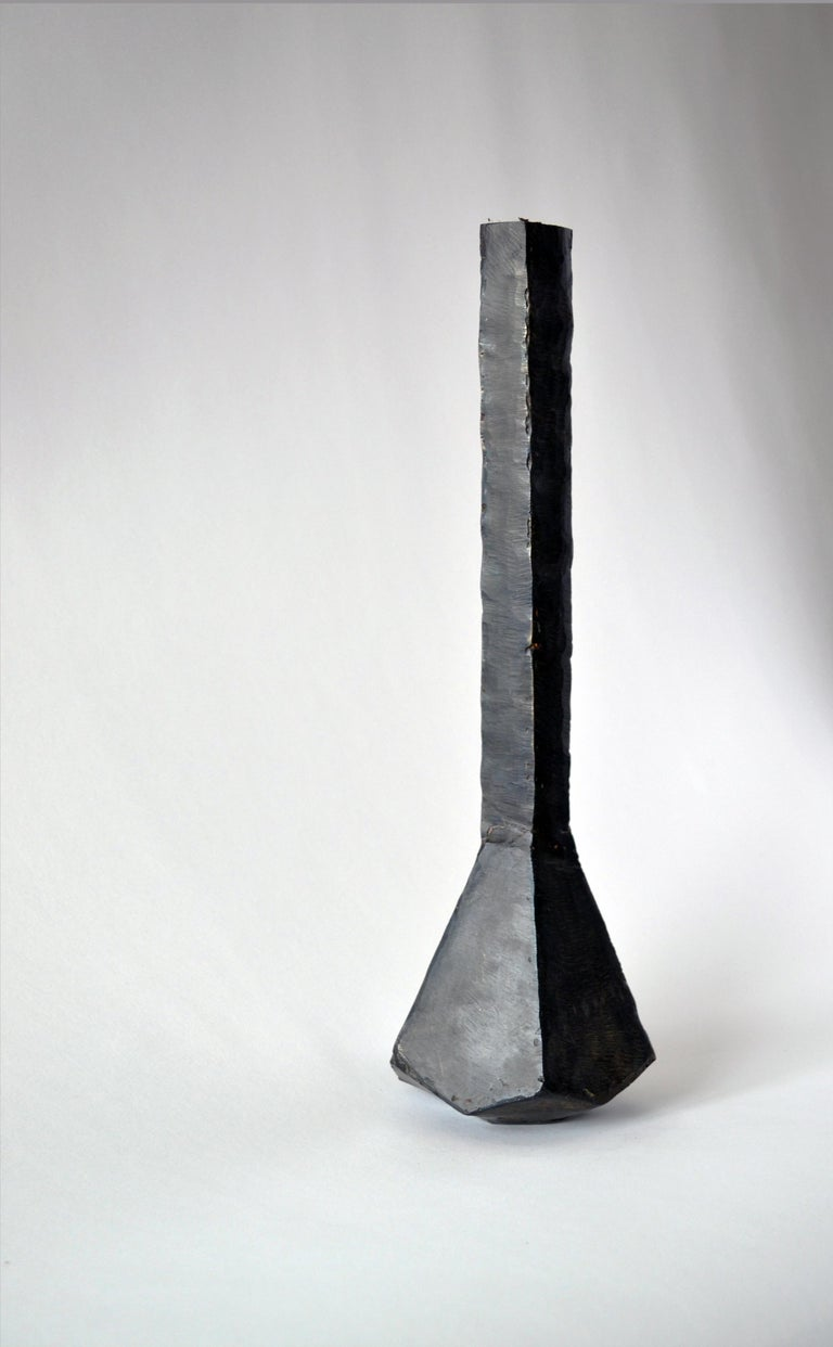 Vessel No 2. J.M. Szymanski d. 2017 Blackened and waxed iron  This is a unique architectural object made entirely of iron. J.M. Szymanski uses a unique process of metal sculpting to achieve these dynamic facets. It is finished in a black wax.