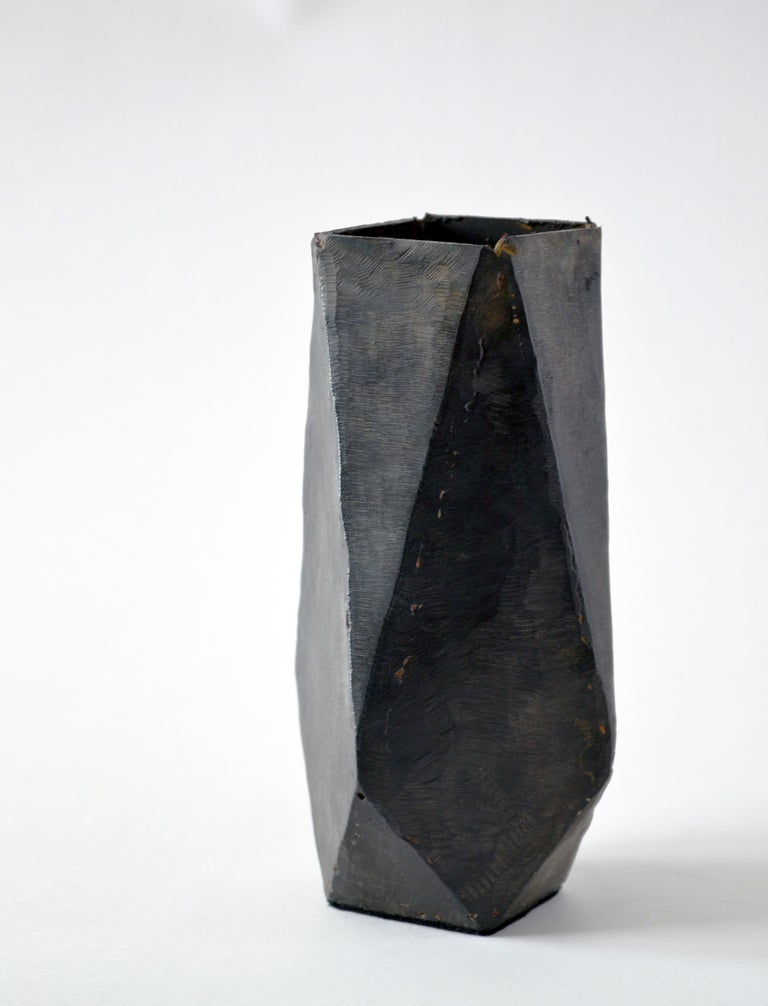 Vessel No 6. J.M. Szymanski d. 2017 Blackened and waxed iron  This is a unique architectural object made entirely of iron. J.M. Szymanski uses a unique process of metal sculpting to achieve these dynamic facets. It is finished in a black wax.