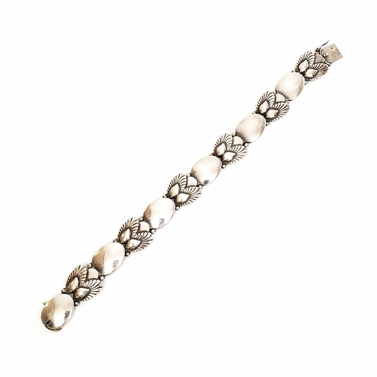 Vintage Georg Jensen sterling silver bracelet in the Bittersweet pattern, #94B, circa 1945.  The Bittersweet flatware pattern was designed by Gundorph Albertus in 1940. This bracelet is typical of Georg Jensen pieces in that it is inspired by nature