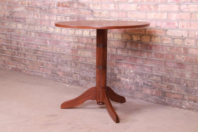 An exceptional Danish Modern teak pedestal occasional side table  By Georg Jensen for Kubus,  Denmark, 1960s  Measures: 31.63