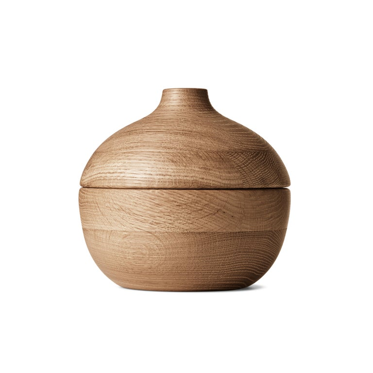 Combining beauty with function, designer Henning Koppel spent his career creating objects that were striking in form and practical in use. One such item was the oak bonbonnière. Designed in the 1960s, the acorn-shaped holder was never produced