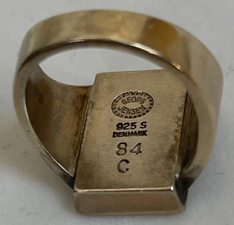Stylish Men's Sterling Silver Signet Ring by Danish artist Georg Jensen. Hand crafted in Sterling Silver.  Marked on interior: GEORG JENSEN (in dotted oval) 925 S DENMARK 84 C. Ring size 7, we offer ring resizing and monogram engraving. Beautiful