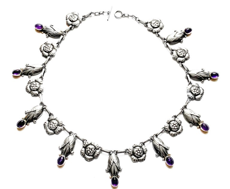 Georg Jensen rare design sterling amethyst necklace C.1930, design No. 6. The Necklace composed of rosette leaf and drop bud motifs. Length: 18.00 inches. Item Weight: 56.7 grams. Marks for Georg Jensen, GJ, 925 Sterling Denmark, 6.