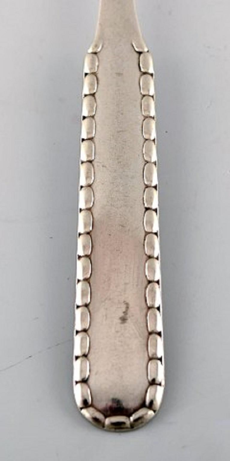 Georg Jensen Rope meat fork in silver. 1920. Silver Measures 18.5 cm. In very good condition. Early stamp. 2 pieces in stock.