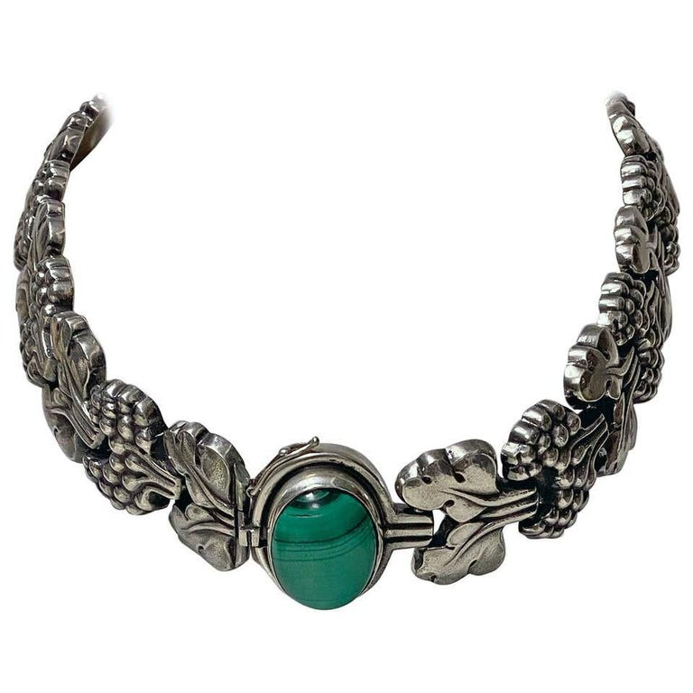 An extremely rare Georg Jensen sterling silver PARIS Necklace No 30, Denmark, C.1945. Set with a large oval cabochon Malachite stone. A similar example bracelet with amber is featured in Drucker reference Georg Jensen, a tradition of splendid