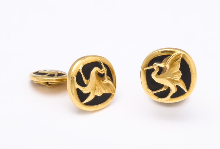 Georg Jensen cufflinks in black matte enamel and yellow gold, depicting a large flying bird. 29 grams, in excellent condition. Circa 1930.   Materials: Yellow Gold Black Matte Enamel  Measurements: 29 grams