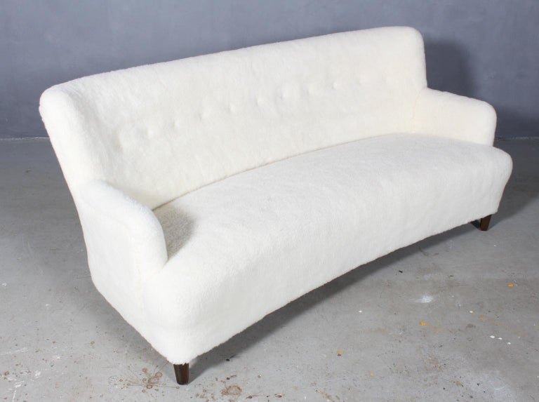 Georg Kofoed three-seat sofa new upholstered with lambwool.  Legs of stained beech.  Made by Georg Kofoed in the 1940s.