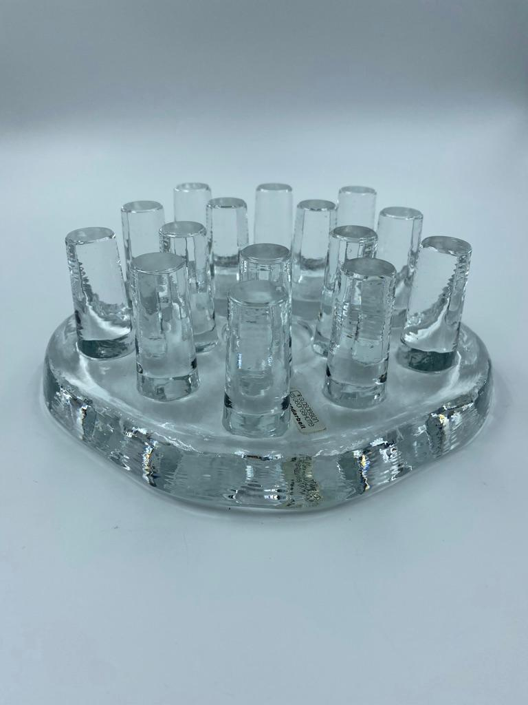 Very modern and stylish handmade pieces. Makes a very nice centre piece. Designed to keep tea/coffee pots heated by a candle placed in the centre of the piece. Pot is placed on the vertical pillars set into the base the tips of which are part ground