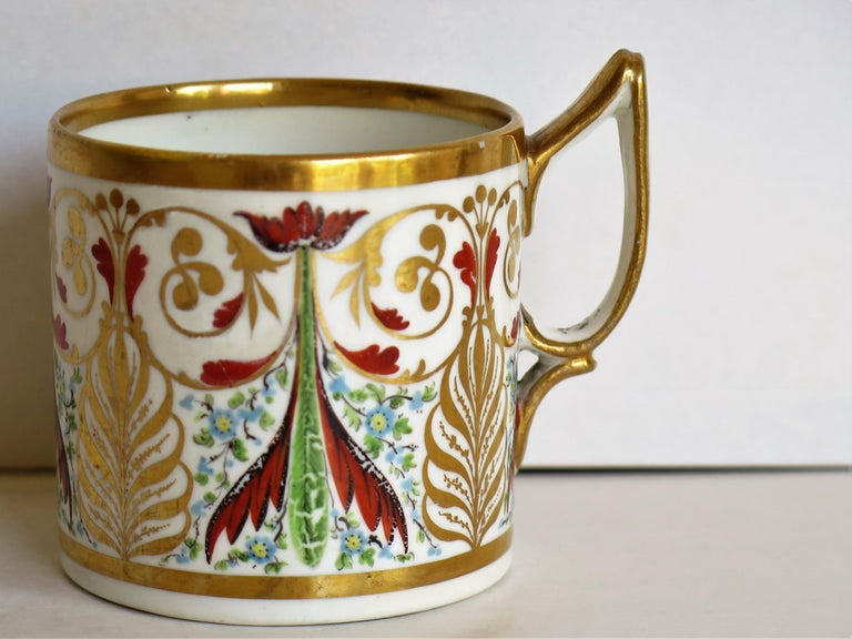 This is a highly collectable, hand-painted porcelain coffee can (cup) , made by Derby porcelain Co., England in the George III period, circa 1810.  The coffee can is straight sided and nominally 2.5 inches square excluding the handle. The handle