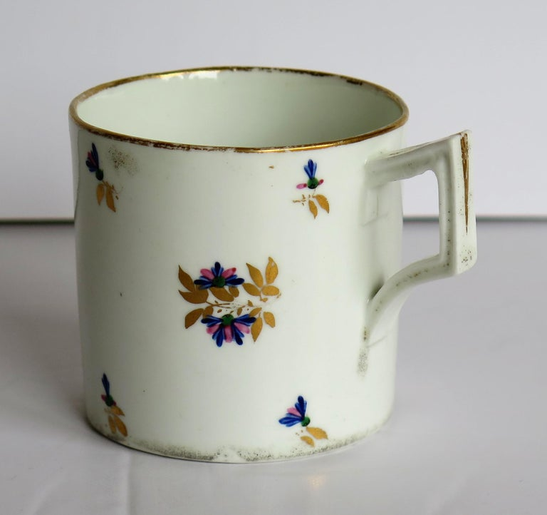 This is a good porcelain Coffee Can or cup hand painted and gilded in pattern 129, made by the Derby factory, in the reign of George 111 in the early 19th century, circa 1805 to 1810.