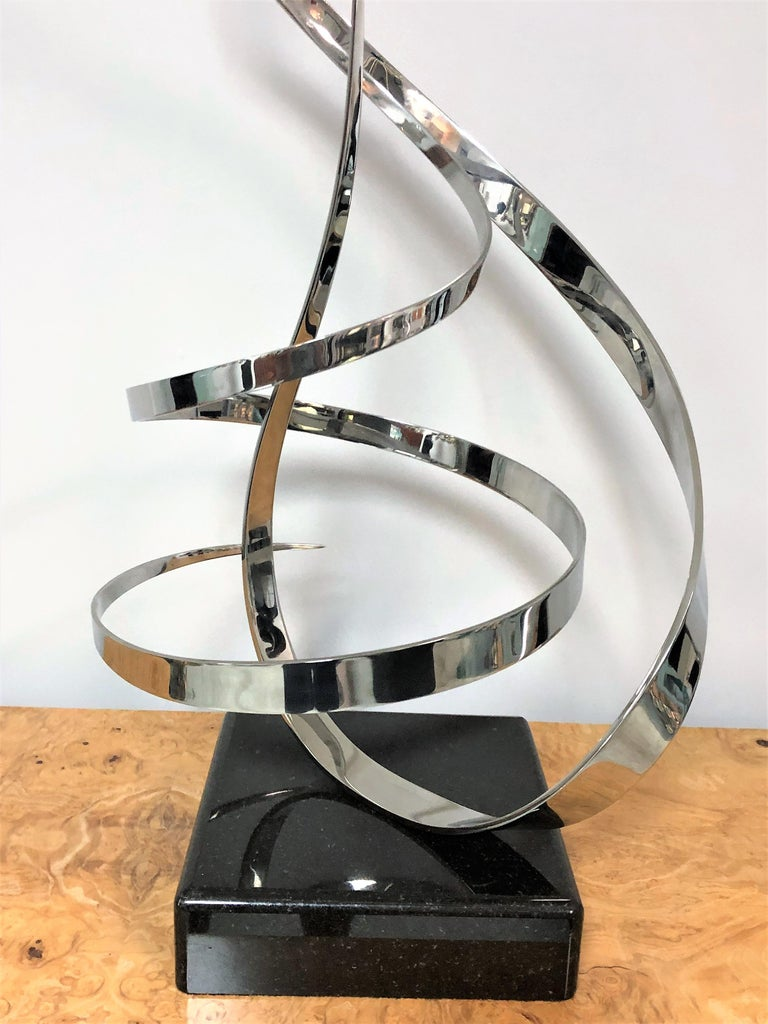 A very large kinetic sculpture by George Beckman. Marble base. The sculpture is conceived in 2 pieces, one stable that is attached to the base and the other one is perfectly balanced on an axis and can swivel freely on 2 directions.