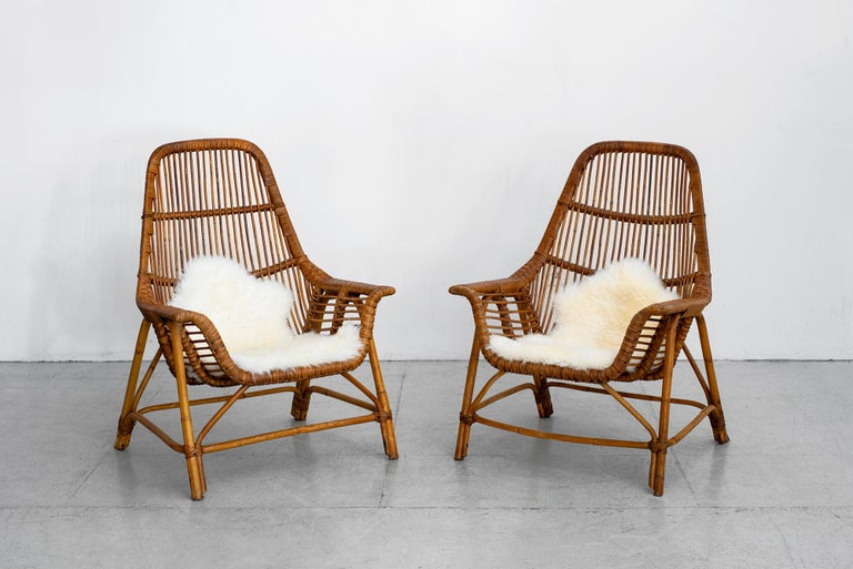Wonderful pair of rattan chairs by Georges Coslin, France, circa 1956 Sculptural scoop shape.