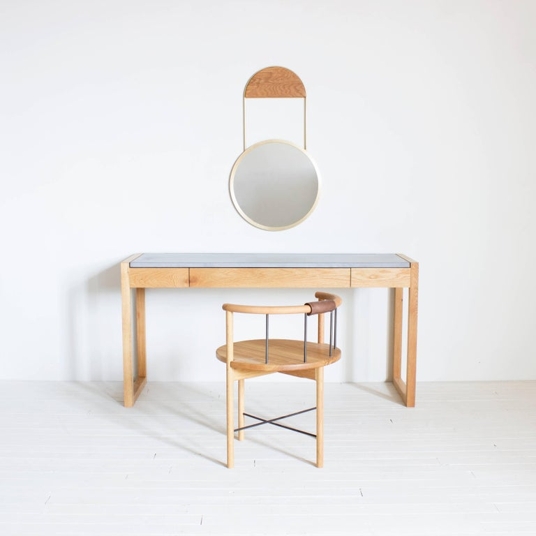 Solid wood frame / honed concrete top / choice of integral color / cast in pencil line / natural oil finish / soft close pencil drawer   Dimensions :  60 W x 30 H x 20 D  Wood: Walnut, maple, white oak, blackened oak  Concrete: White, light