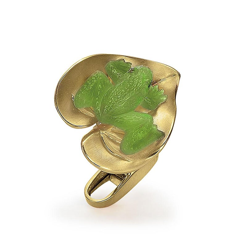 Created by George Gero, renowned worldwide for luxurious men's cuff-links, comes these whimsical and wearable unique pair. A hand carved agate frog sits on top of a yellow gold lily pad. The frogs have ruby eyes. The bar backs are