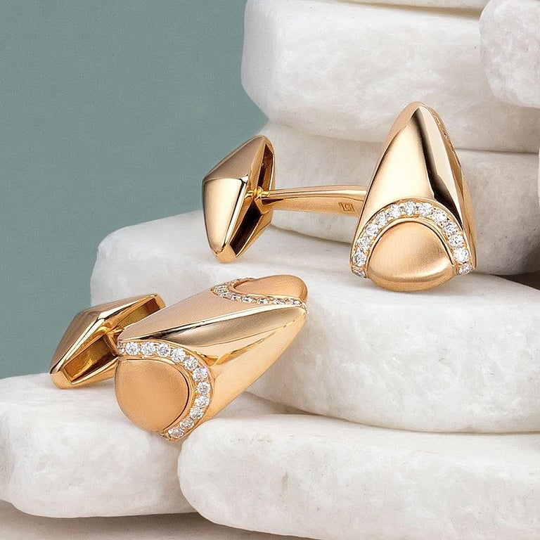 Created by George Gero , renowned worldwide for luxurious men's cuff-links. This 18-karat rose gold pair is crafted with brushed and high polished gold detailing and set with diamond pavé  . Diamond weight: approximately 1.03 carats total. Stamped