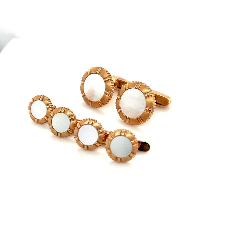 Created by George Gero, renowned worldwide for luxurious men's cuff-links, comes this classic cuff-links /studs dress set in 18 karat rose gold. The round coin edged set are crafted with Pinctada Maxima which is also known as the Australian South