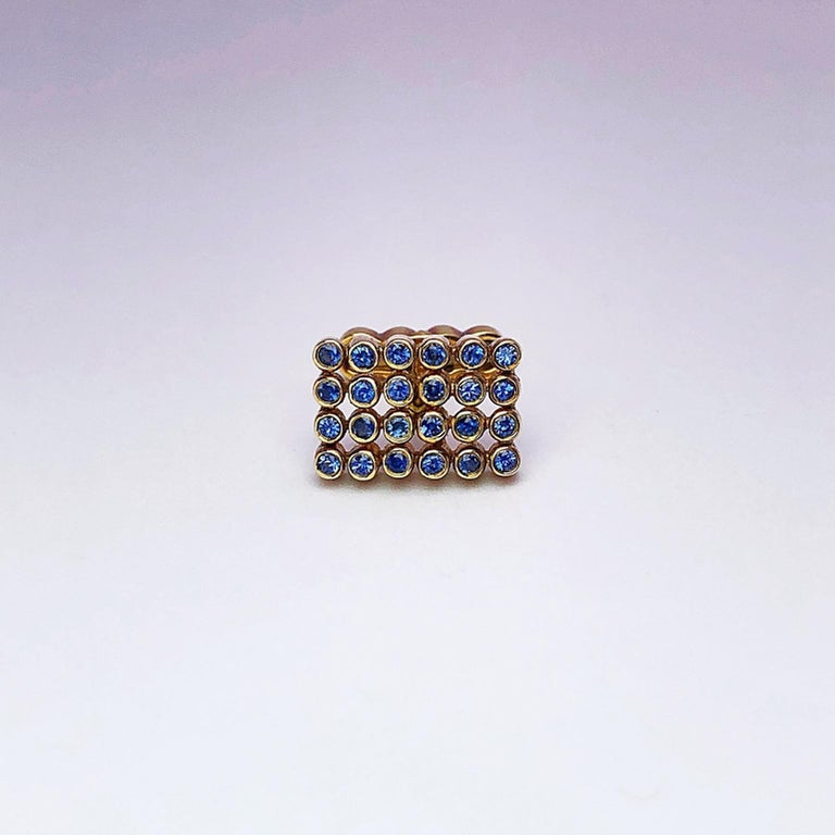 Created by George Gero ,renowned worldwide for luxurious men's cuff-links, comes this classic  rectangular shaped pair in 18 karat yellow gold with blue sapphires in tube settings. The collapsible backs are designed with four circles that mimic the