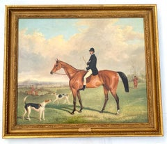 Fox Huntsman seated on a Chestnut horse, with hounds in an English landscape.