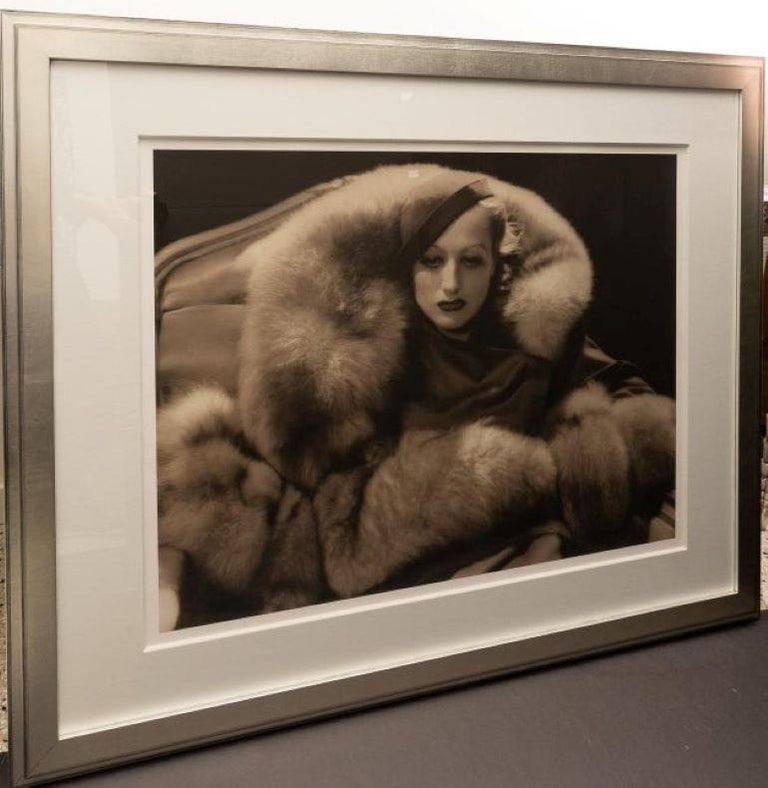 This large scale photograph of the iconic, Hollywood movie star Joan Crawford was originally taken in 1933 by George Hurrell. The photo was for the on-screen role that Crawford played as Letty Lynton.  The original photo was taken in 1933 and this