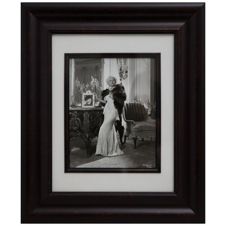 Offered is a striking, signed vintage silver print photograph in the Art Deco style of Hollywood actress Jean Harlow. Hurrell worked for MGM and Warner Brothers. In the 1930'S and opened his own studio on Sunset Boulevard. He photographed almost