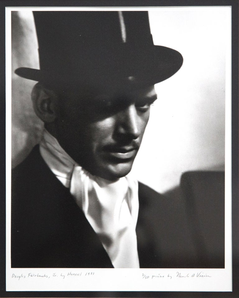 Offered is a striking, signed vintage silver print photograph in the Art Deco style of Hollywood Actor Douglas Fairbanks, Jr. Hurrell worked for MGM and Warner Brothers. In the 1930s and opened his own studio on Sunset Boulevard. He photographed