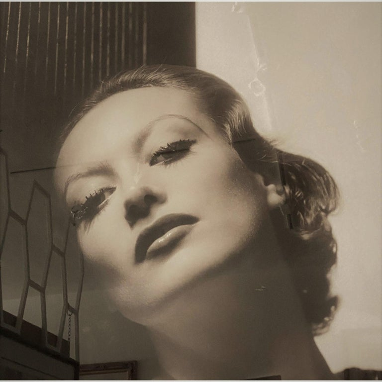 This large scale photograph of the iconic, Hollywood movie star Joan Crawford was originally taken in 1932 by George Hurrell. This image depicts Crawford in the on-screen role as Letty Lynton, .a torrid love story and suspense drama based on a novel
