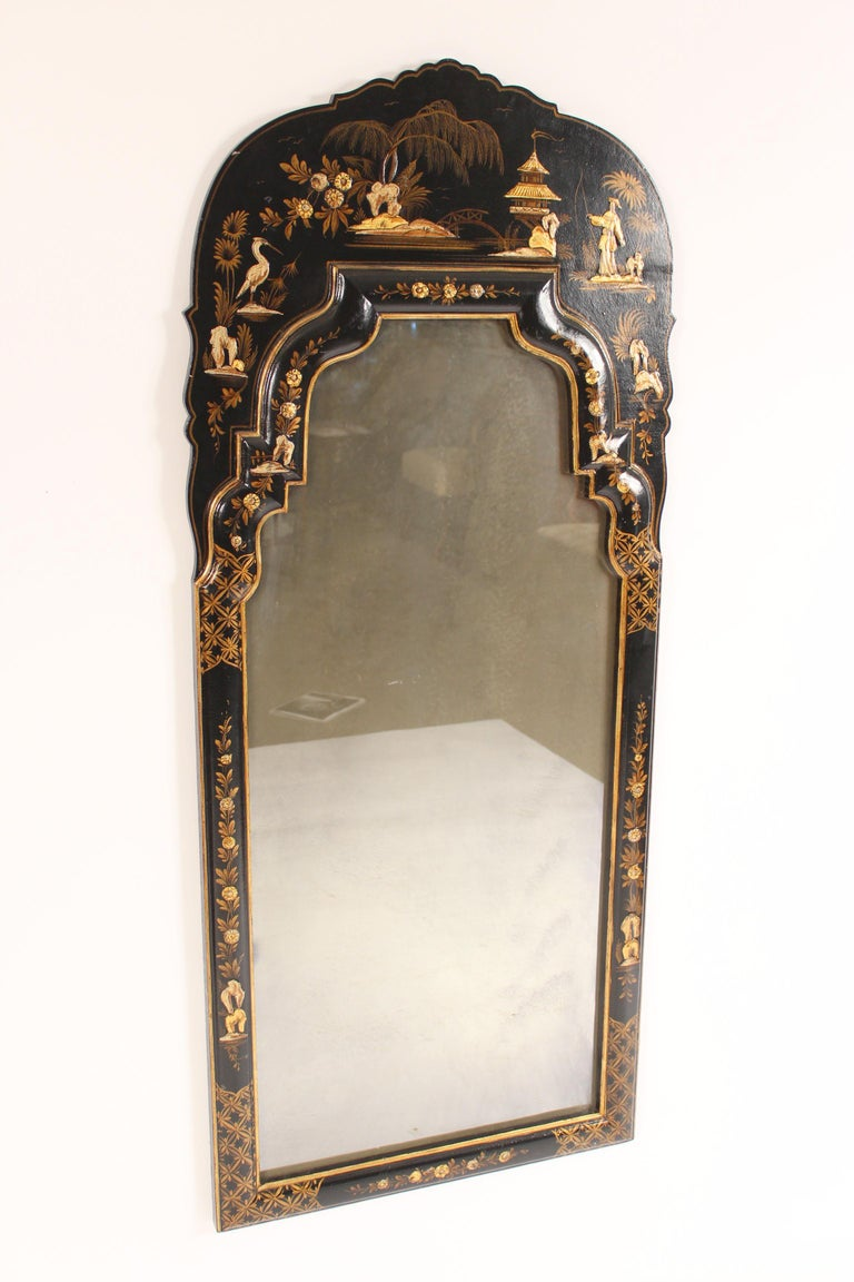 George I style black chinoiserie decorated mirror, late 20th century. With raised chinoiserie decorations.