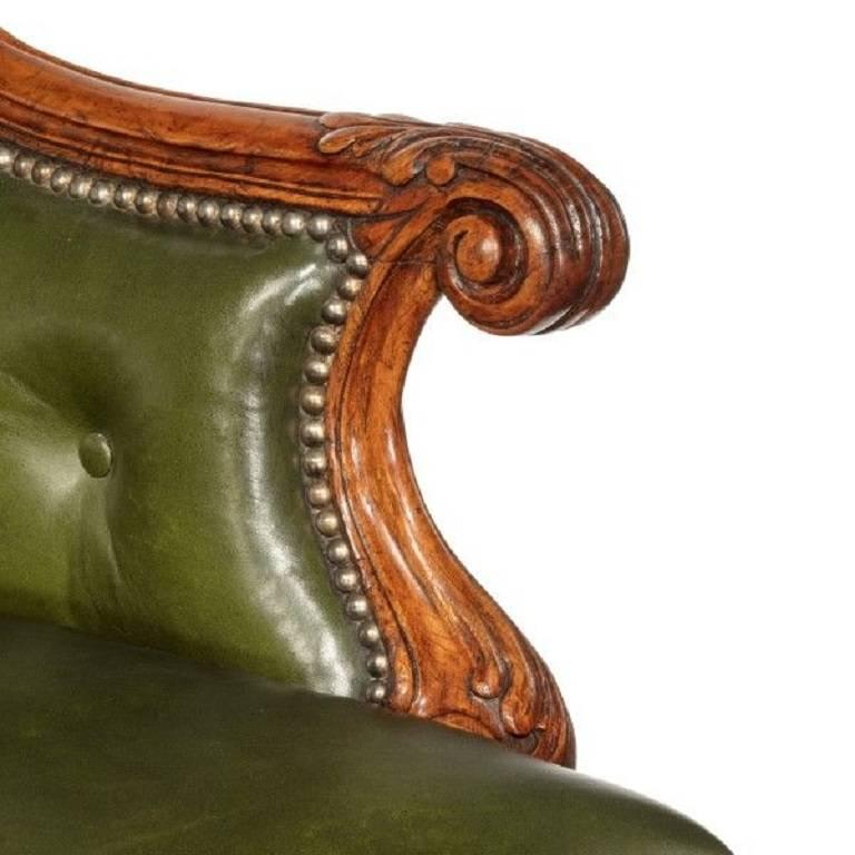 A George I walnut armchair of generous proportions, re-upholstered in distressed green leather, English, circa 1720.   Measures: Seat depth 20in, width 28in.