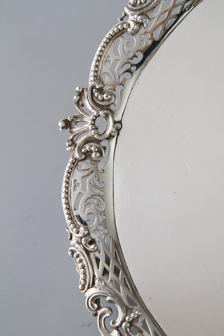 A rare and superb George II silver salver of shaped circular form flat sheet set into a cast floral and beaded scroll gallery. Standing on three openwork cast shell, scroll feet.  Hallmarked to the underside for London 1759 by Samuel Courtauld.