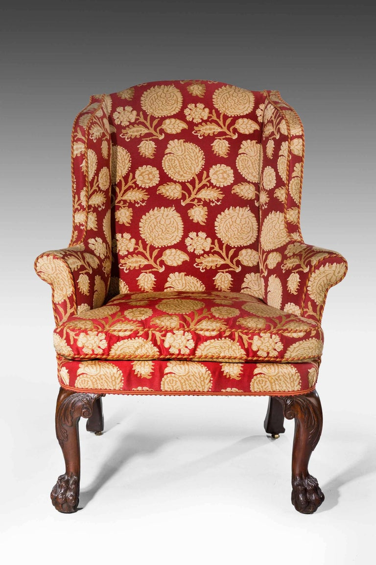 George II period wing chair of good proportions, cabriole supports with scroll work to upper section. Walnut.