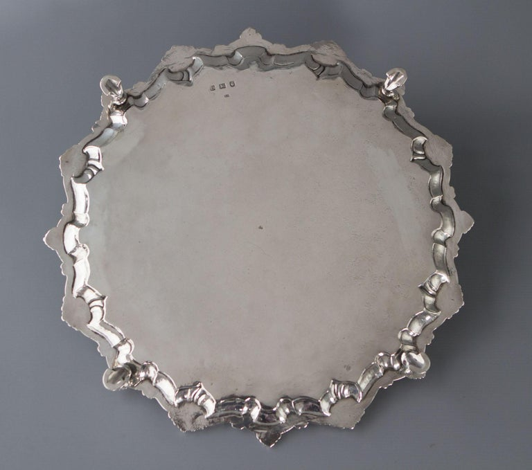 An excellent silver salver with scrolling shell pattern rim and the whole resting on four hoof feet. The center engraved with an armorial. (see pictures) The armorial is surrounded by a beautiful floral engraved design.   Hallmarked for London