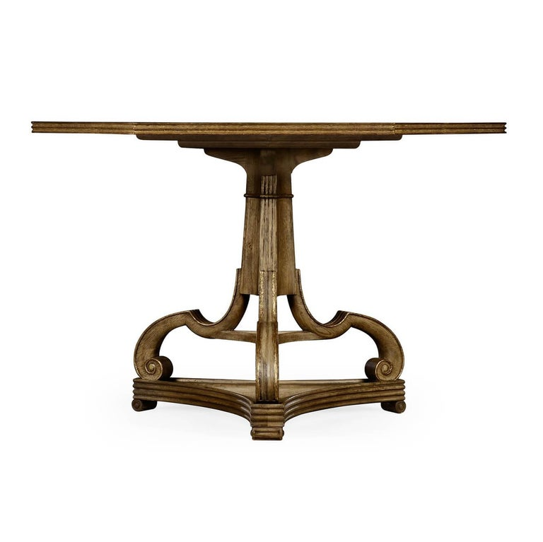 An unusual George II style Corwen center table with a hexagonal faux marble painted top and the dirty gilt applied to the washed oak base.  Dimensions: 52