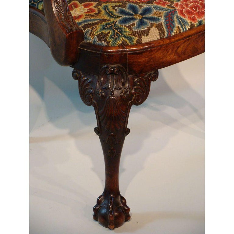 Raised on ball and claw cabriole legs, well carved at the knees.   The arms with 'Eagle' carved terminals. Antique, 19th century.   The shaped seat now covered in 18th century gros point needlework of a shepherd in a central panel surrounded by