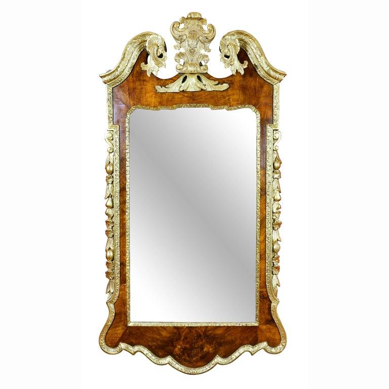 George II Walnut and Parcel Gilt Mirror